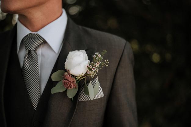 closeup-shot-male-wearing-tuxedo-with-boutonniere-its-pocket_181624-3585